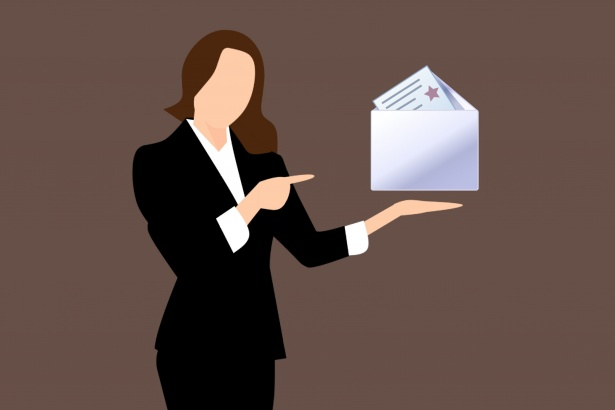 This is an image of a businesswoman holding an email icon.