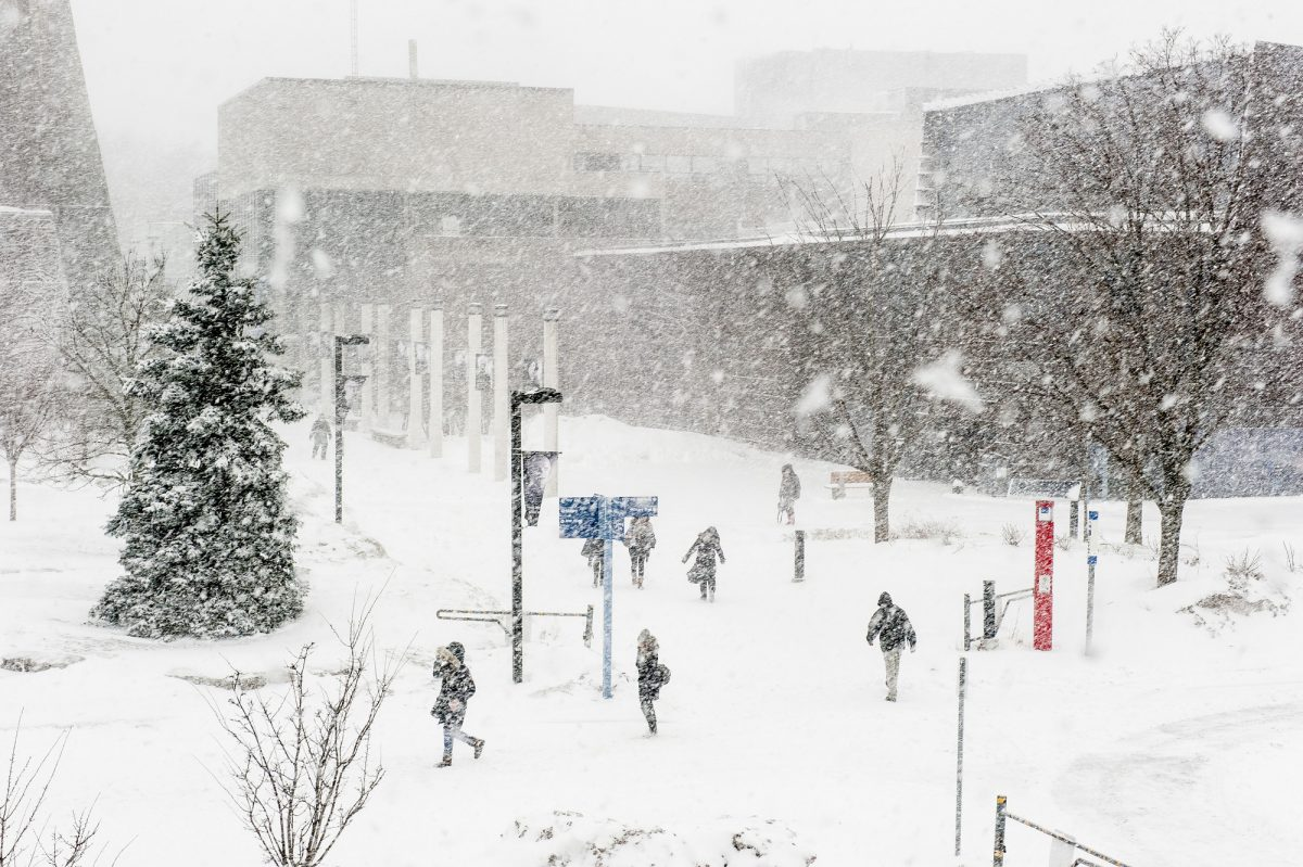 UTSC during a snowstorm with students struggling through the snow.