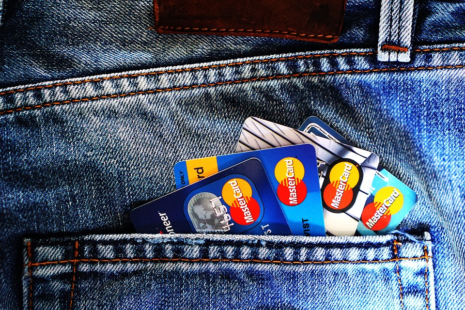 Credit cards in jeans pockets.